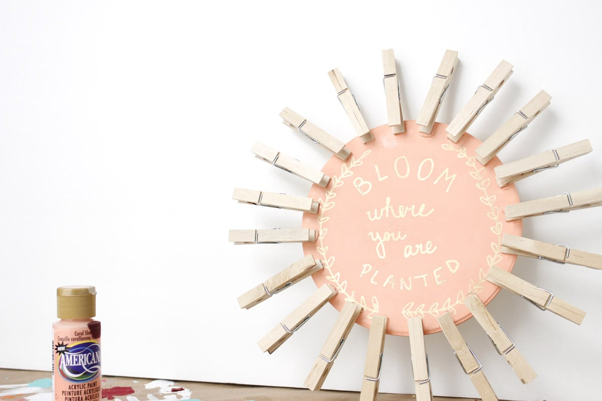 Looking for a way to spice up your dorm room or home? This DIY clothespin picture display is inexpensive and easy! Check out the post to find out how to make it! // DIY dorm decor, DIY picture display, DIY clothespin wreath